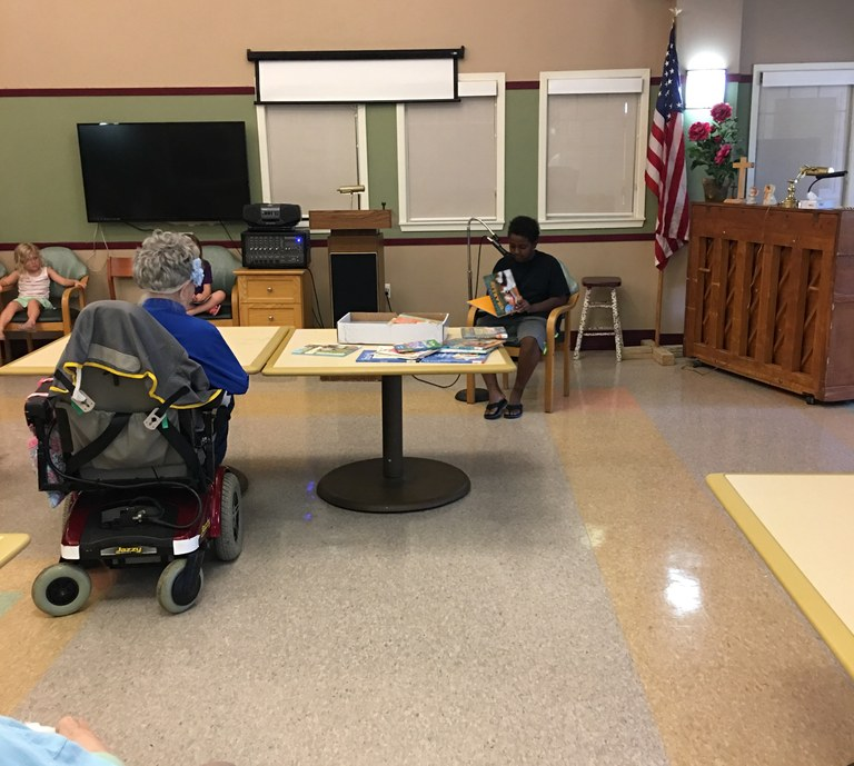Child reading to patients